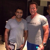 Suriya meets Arnold Schwarzenegger