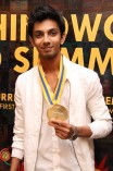 Anirudh receiving BW Gold Medal from AR Rahman