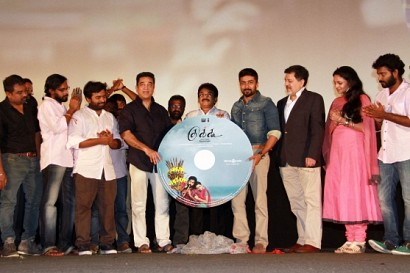 Suriya bows down to the Cuckoo team on stage at the music Launch