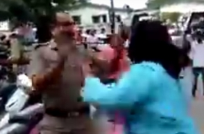 Woman slaps police in broad daylight
