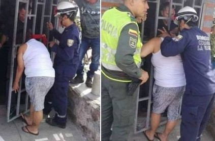 Woman spy\'s on neighbour, gets head stuck in metal gate