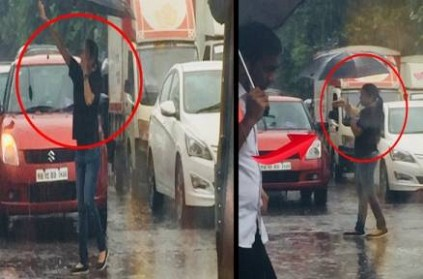 Check What This Mystery Girl Is Doing In Rain!
