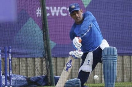 Dhoni practices spin shots during net practice session