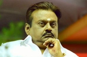 Shocking: Stone pelted on stage where Vijayakanth was speaking