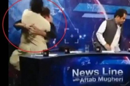 Pakistan leader pushes, punches journalist on live television show