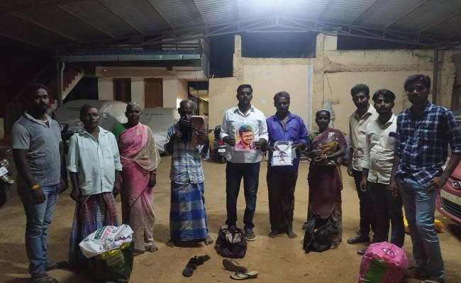 Vijay fans gift new clothes and sweets to cobbler